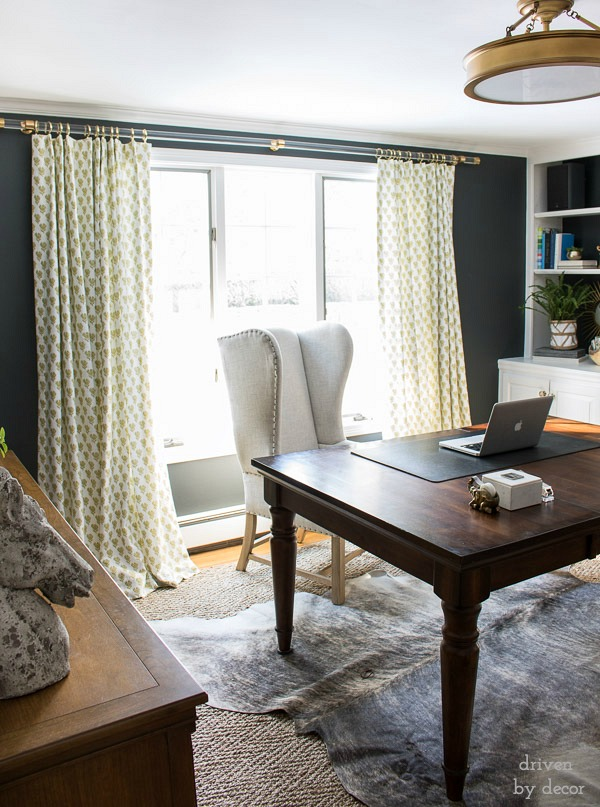 Tip for decorating with neutrals - add a little pop of color like the citrine print of these drapes in an otherwise neutral-filled home office
