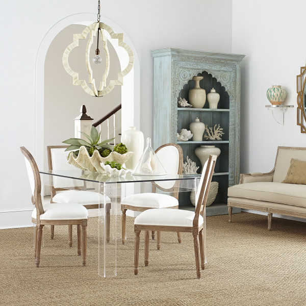 Acrylic dining table - love how it opens up the space!