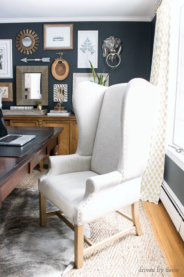 An upholstered wingback chair works as a desk chair in our home office