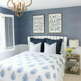 Light blue grasscloth wallpaper | gold quatrefoil pendant | hand-blocked quilt