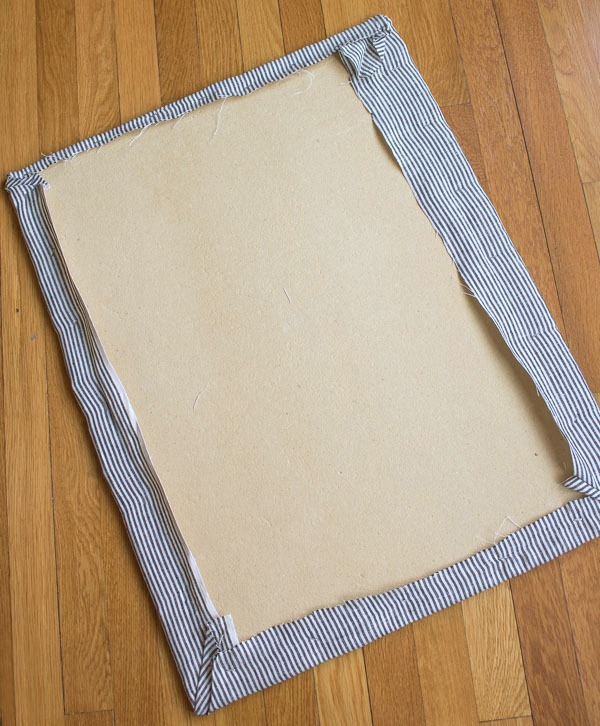 Step in making DIY fabric covered cork board