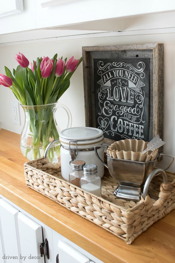 Use a small tray to corral your coffee-making supplies for a simple at-home coffee station!