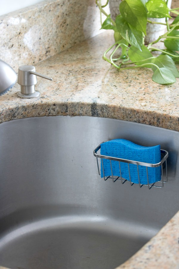 Another favorite simple way to organize your kitchen - a sponge holder suction cupped to the side of the sink!