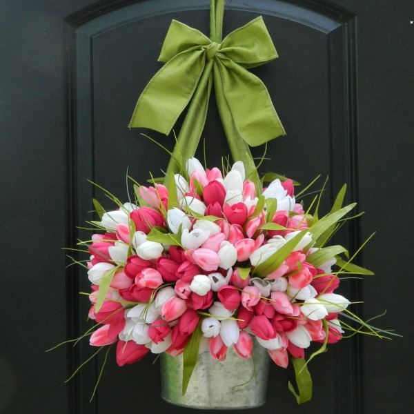 Gorgeous spring door decoration with colorful tulips in a galvanized metal planter