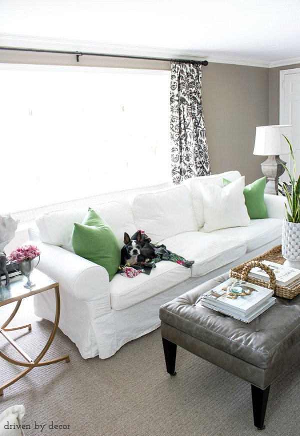 Green IKEA VIGDIS pillow covers add an inexpensive pop of color to this living room for spring