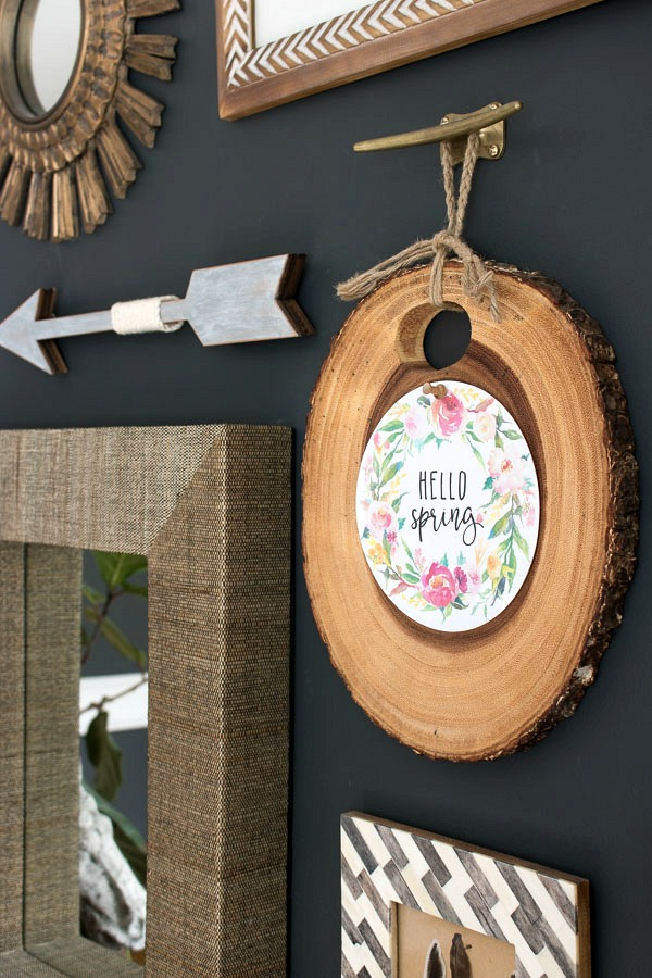 Hello Spring printable tacked to tree slice as part of an eclectic gallery wall (post includes link to printable!)