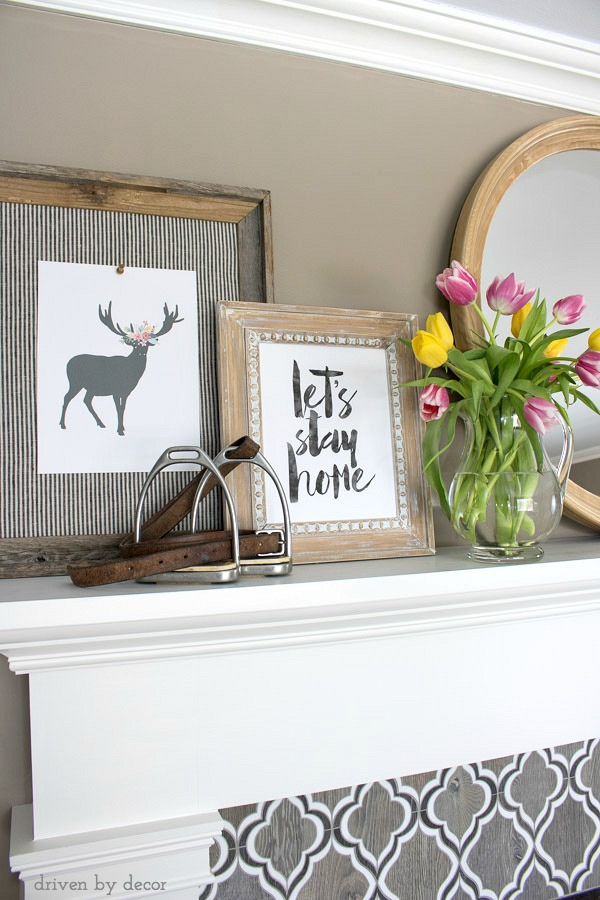 Spring fireplace mantel decorated with inexpensive printables (links to printables in post!)