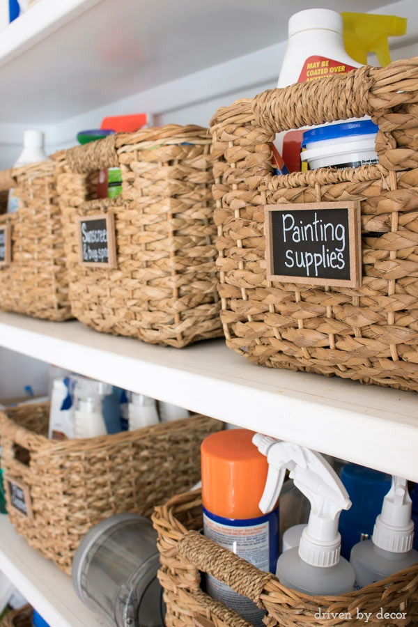 Woven baskets with cute mini chalkboards were used to whip this mess of cleaning and painting supplies into shape!