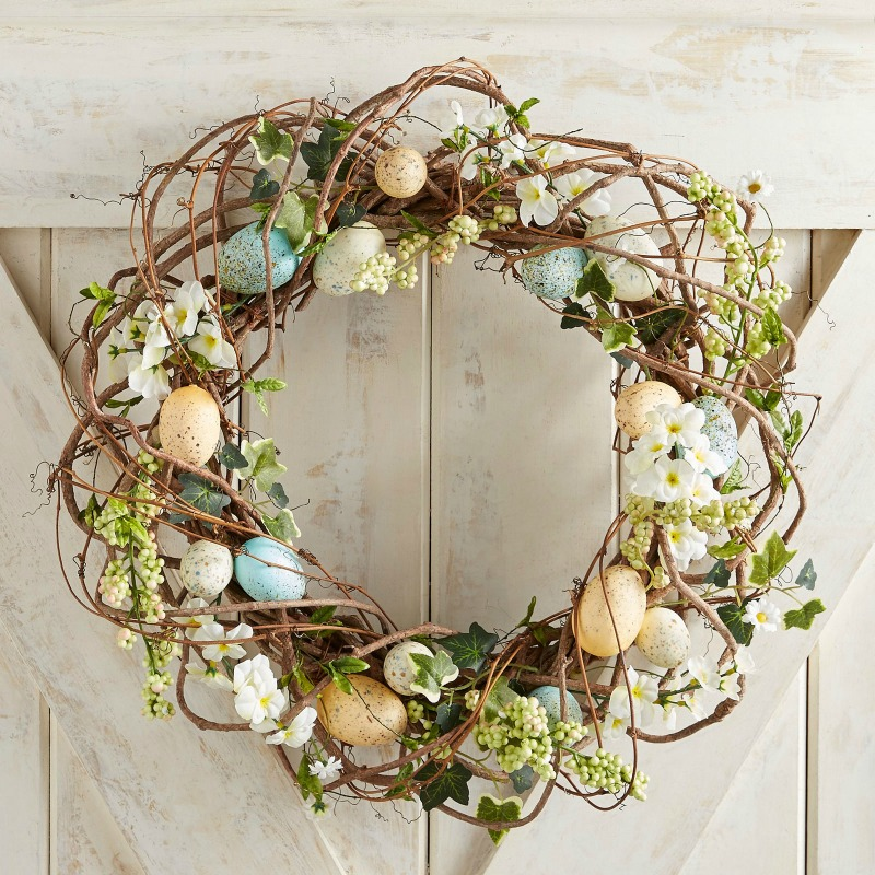 Gorgeous spring grapevine wreath sprinkled with the cutest colored eggs!