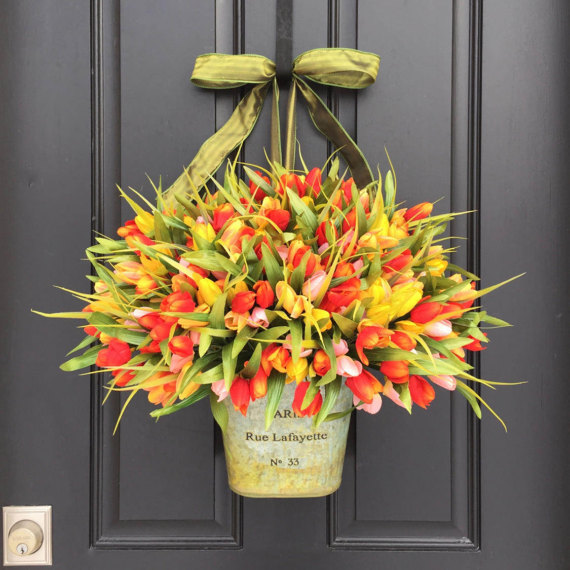 One of my favorite spring door decorations - a bucket of colorful faux tulips!