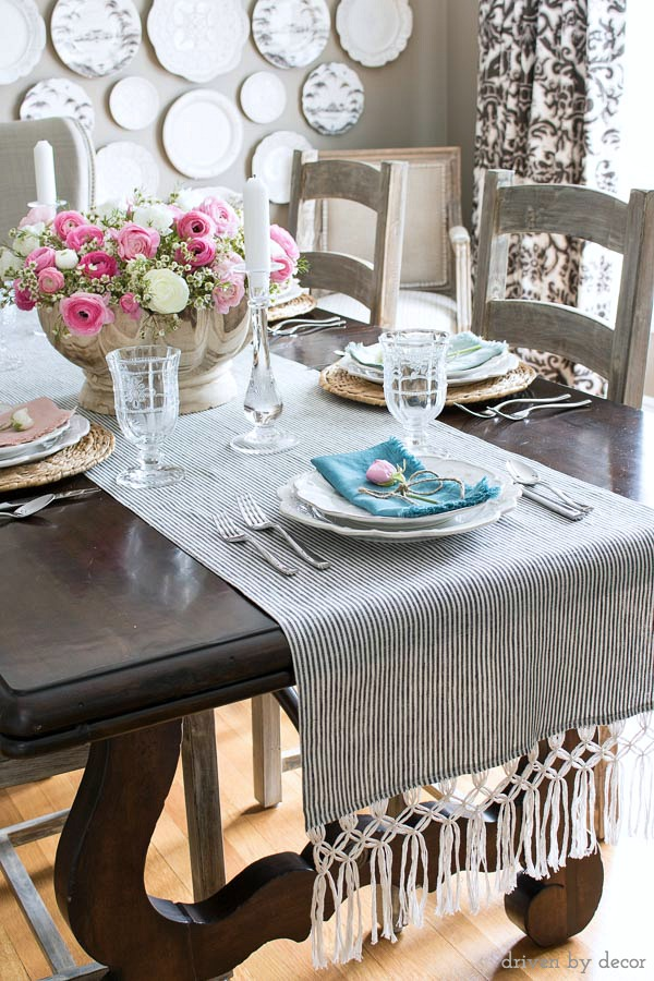 Beautiful table runner that's a DIY with macrame fringe added to ends