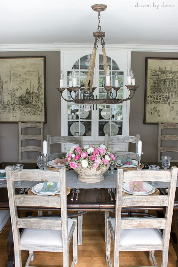 Dining Room In Neutrals With A Colorful Spring Centerpiece Of Pink And White Ranunculus