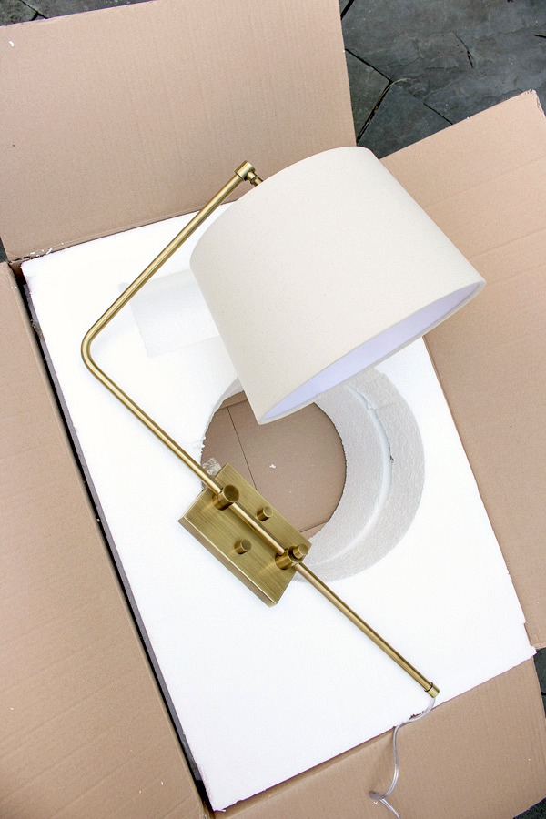 Gold swing arm light with natural shade