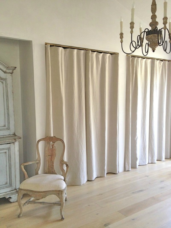 Love how drapes were used instead of doors on these gorgeous closets