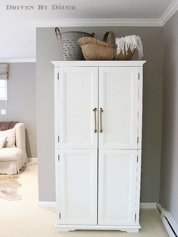 Old TV armoire painted white and transformed into a clothes armoire