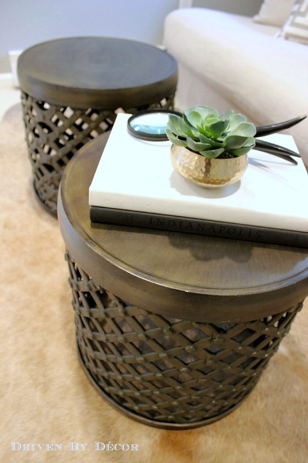 Pair of metal drum tables used in place of a coffee table