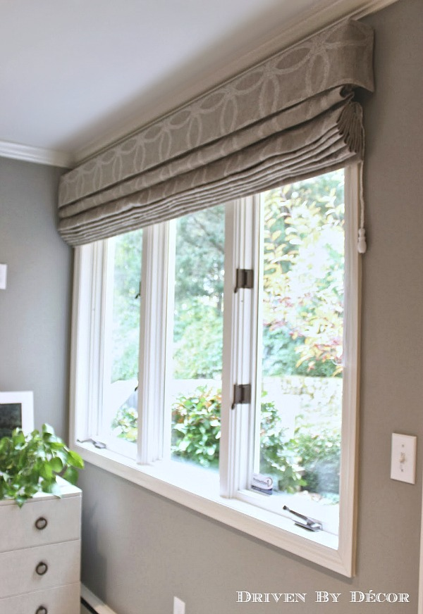 Roman shades in a patterned neutral fabric