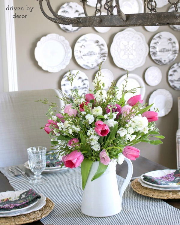 Spring centerpiece with tulips, snapdragons, and ranunculus in a white pitcher - simple but beautiful!