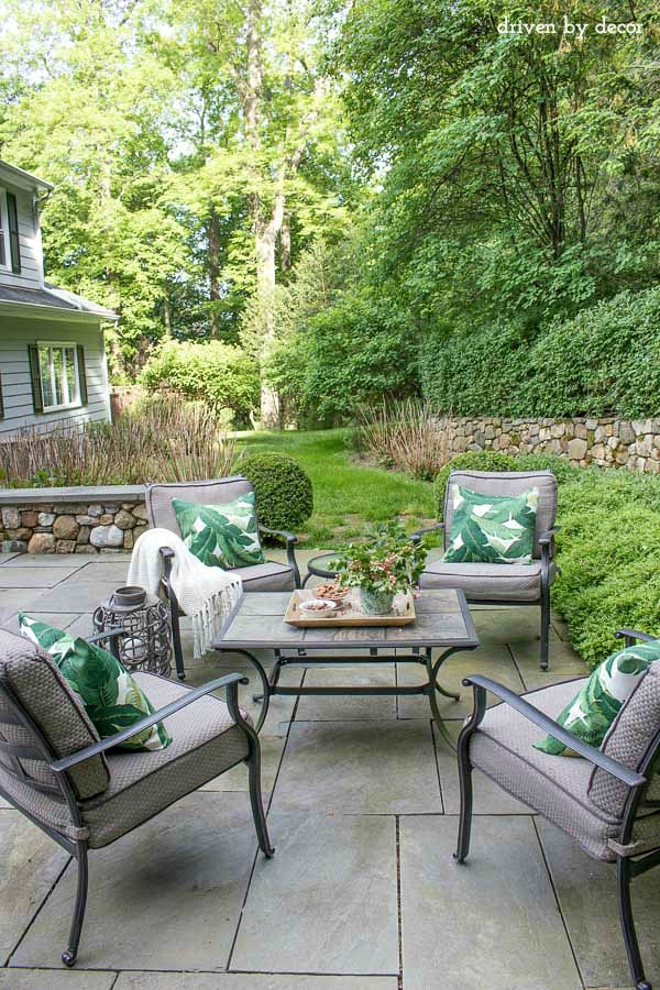 Back patio conversation area with four outdoor club chairs arranged around a coffee table. More & Summer Simplified: Simple Outdoor Decorating Ideas | Driven by Decor