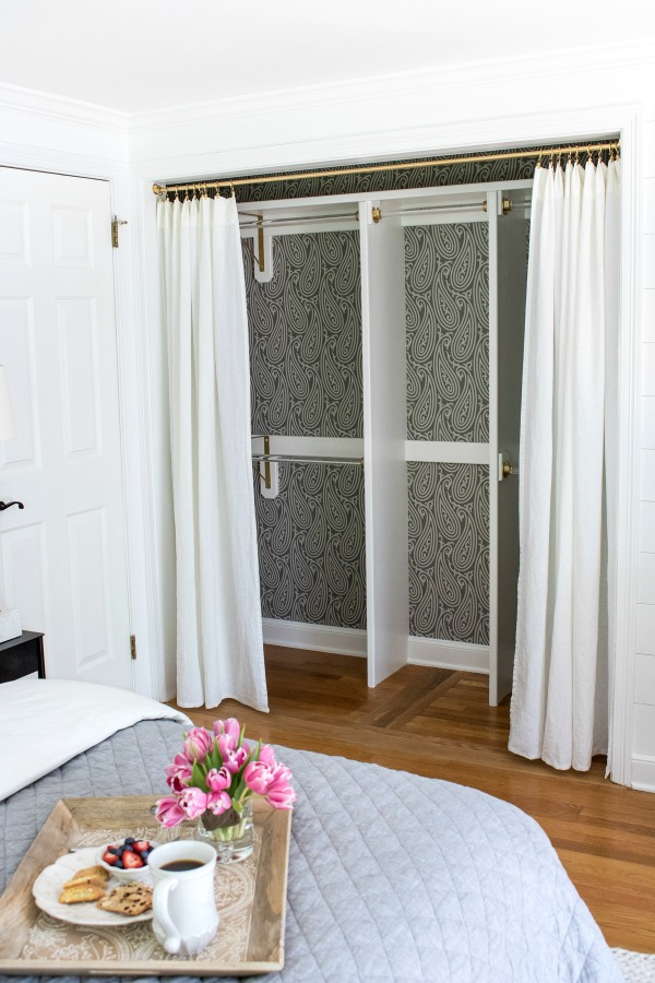 Closet transformed from a double door closet with center partition to one wide opening closed off with drapes - love!