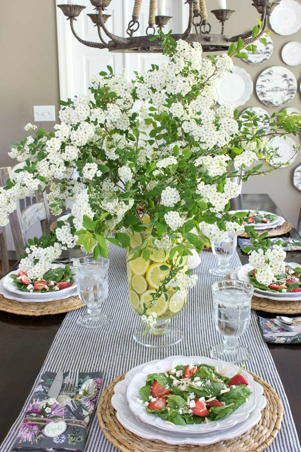 Gorgeous spirea blooms in vase lined with lemon slices - love!
