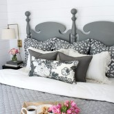Layering of pillows on a king bed for the pillow lover - two euros, two standard shams, two square pillows, and a rectangular pillow