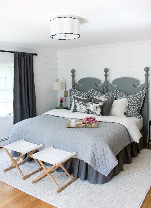 Master bedroom makeover | Shiplap walls |Farrow & Ball All White wall color | Flushmount ceiling fixture | Gray drapes | Patterned pillows | Swing arm sconces | Wood stools