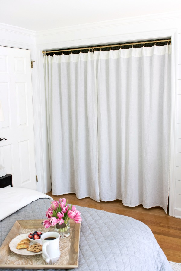 The two doors and center partition of this closet were removed and replaced with a rod & drapes - such a smart update!