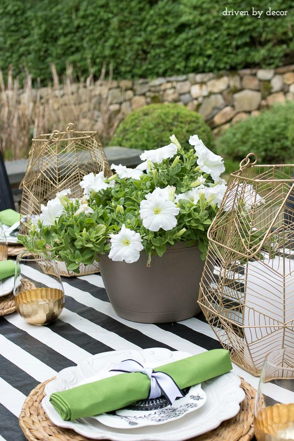 Use a hanging planter as a simple outdoor dining centerpiece! One of the tips for simplifying summer in this post!