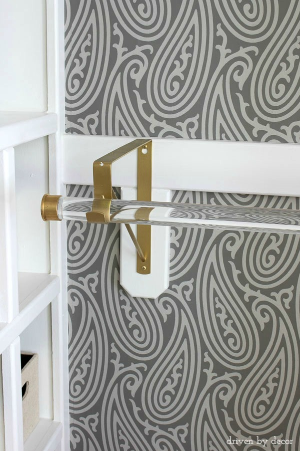 Acrylic closet rods with gold hardware are part of this glam closet makeover