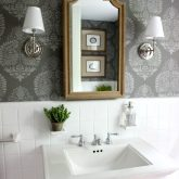 Bathroom makeover (such a huge change from the before!) | Stenciled walls | Pedestal sink | Sconces | Wood medicine cabinet