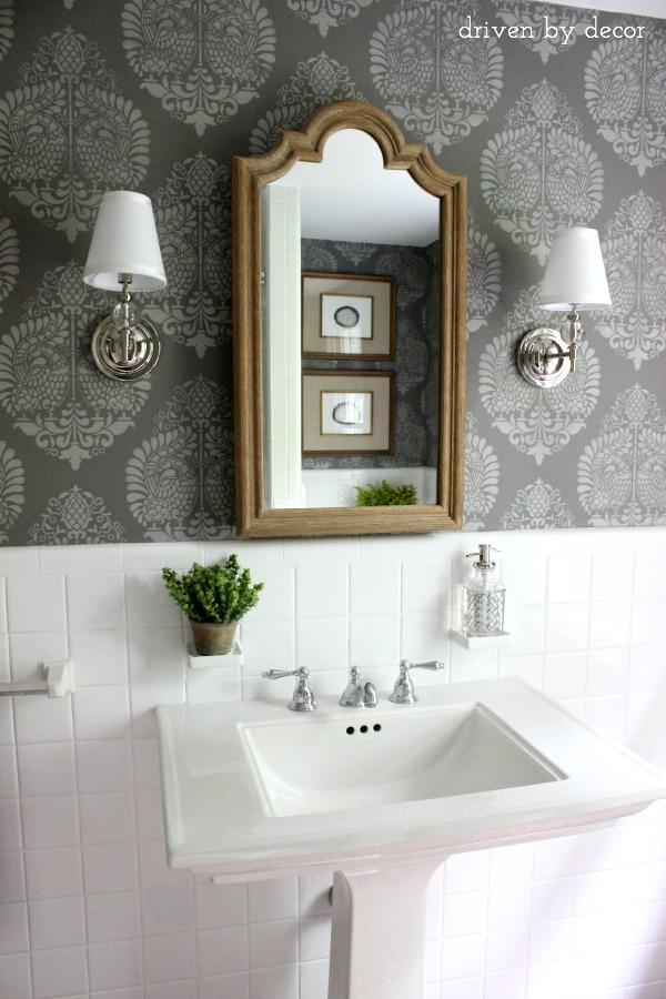 Bathroom makeover (such a huge change from the before!) | Stenciled walls | Pedestal sink | Sconces | Wood medicine cabinet