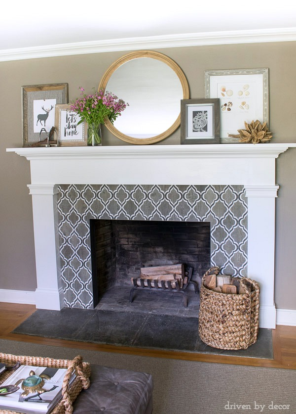 Fireplace with geometric tile surround, round mirror, and layered art (full source list included in post!)