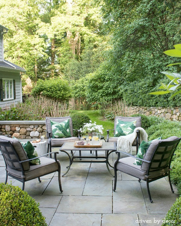Flagstone patio | 4-chair conversation area | garden stool | outdoor pillows