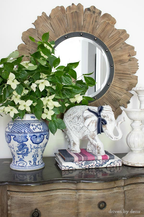 Foyer console with fabulous round wood mirror and simple styling