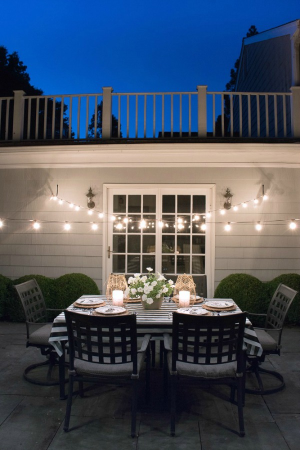 String lights draped over our patio create a dreamy outdoor dining spot