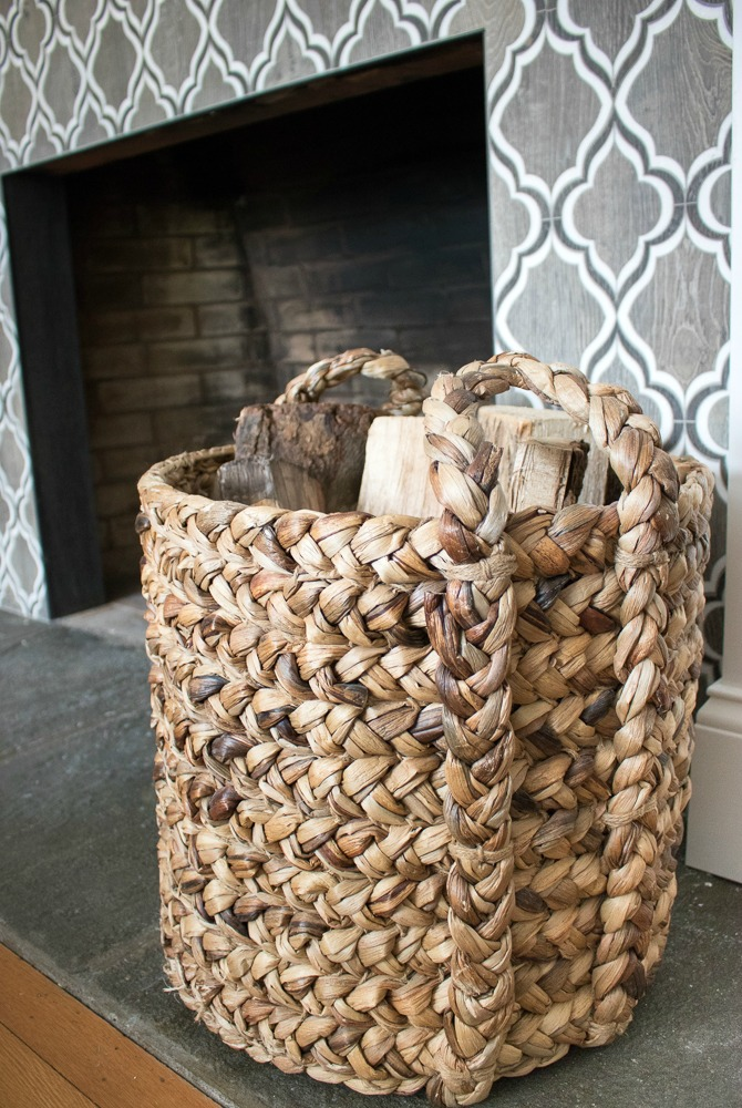 Basket used to store logs by the fireplace - love this idea!