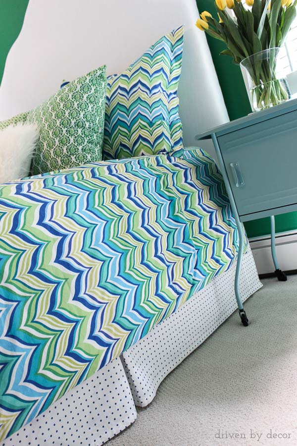 Custom bed skirt made from a simple flat sheet - cheap, easy, and you get a custom fit!