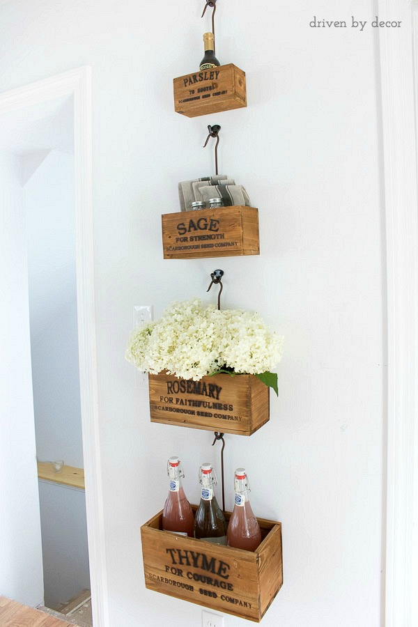 Nesting herb crates hold flowers and other kitchen necessities