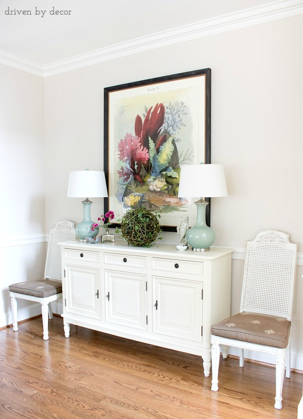Dining room buffet with twin lamps flanking large-scale art