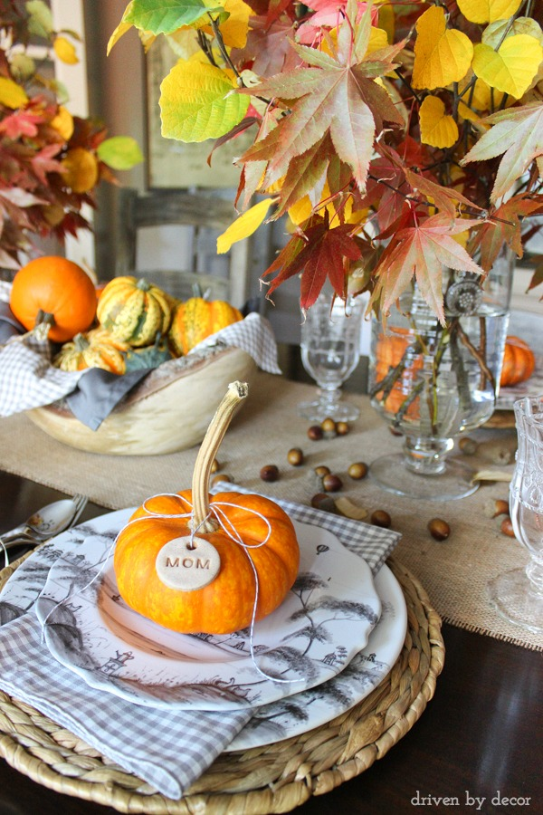 Easy to make dough tags tied onto mini pumpkins are part of this pretty fall tablescape