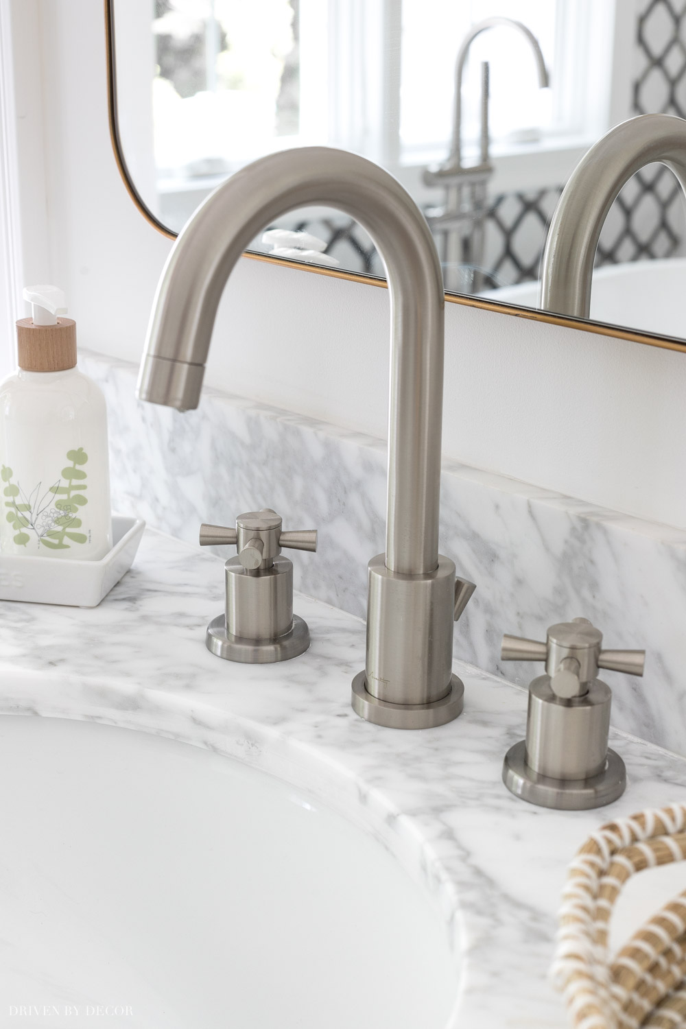 Love how she mixed metals with brushed nickel faucets and gold mirrors and vanity lights