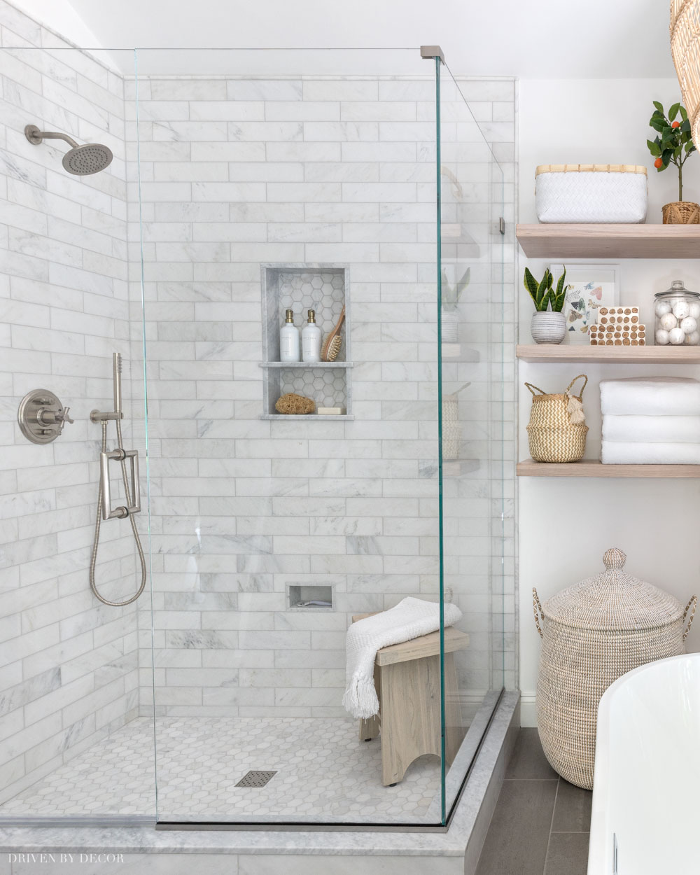 Love how she mixed metals with the brushed nickel finish of her shower hardware + brass accents in other parts of the bathroom