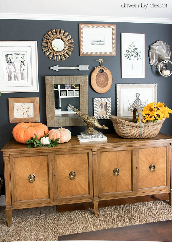 A mix of art, mirrors, and other accessories are part of this eclectic home office art wall