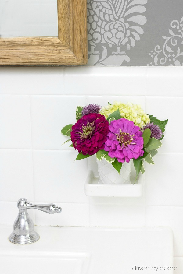 Creative use for a built-in soap dish - use as a spot for flowers!