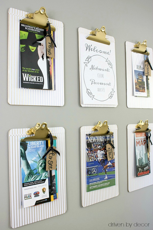 DIY wall-mounted clipboards hold travel info for visiting guests