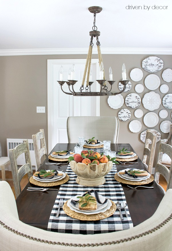 Dining room decorated for fall with simple centerpiece of a bowl of peaches