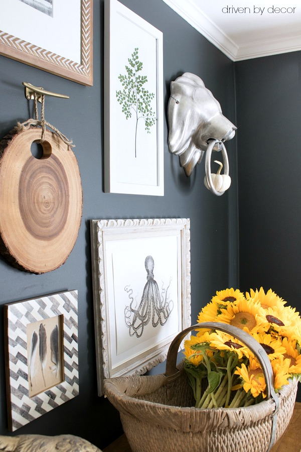 Eclectic gallery wall with a basket of sunflowers for fall