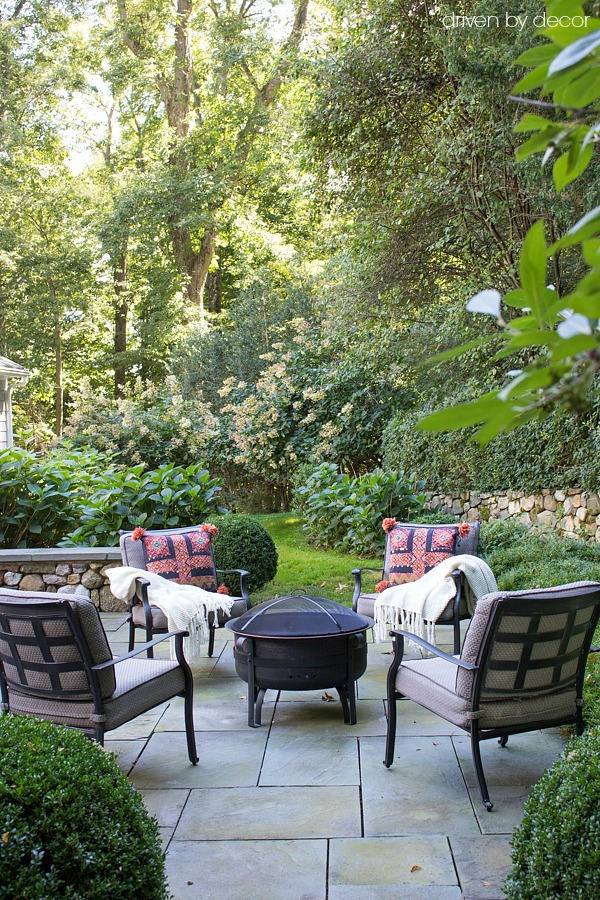 Fall patio with colorful pillows and cozy throws