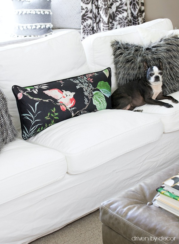 Great printed fabric made into lumbar pillow and paired with faux fur pillows